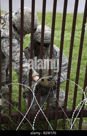 Army engineers with the 887th Engineer Support Company install concertina wire along the fence line near the Gateway International Bridge at the U.S. Customs and Border Protection port of entry in Brownsville, Texas. U.S. Northern Command is providing military support to the Department of Homeland Security and U.S. Customs and Border Protection to secure the southern border of the United States. (Air Force - Stock Photo