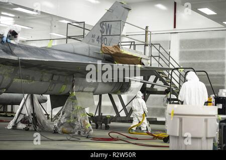 U.S. Airmen assigned to the 20th Equipment Maintenance Squadron corrosion control paint barn, work on an F-16CM Fighting Falcon at Shaw Air Force Base, S.C., Nov. 13, 2018. The maintenance performed on the aircraft helps protect the aircraft from the elements while stateside or overseas.