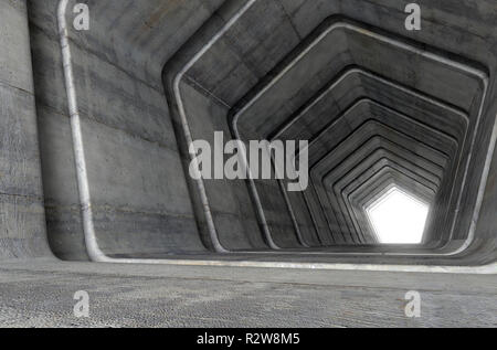 A look down a concrete tunnel made out of pentagonal geometric shapes with a light in the distance at the far end - 3D render - Stock Photo