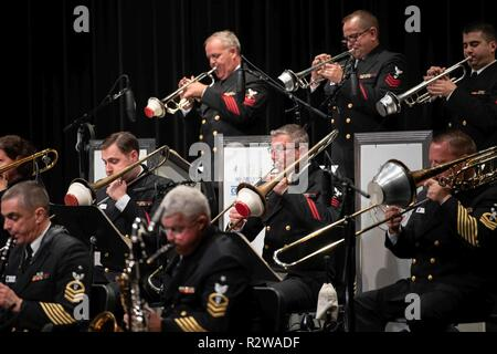 KEY WEST, Fla. (Nov. 14, 2018) Musician 1st Class Andy Skaggs, center, plays trombone with the U.S. Navy Band Commodores jazz ensemble during their final concert at Key West High School. Skaggs, from Ashland, Kentucky, is a member of the U.S. Navy Concert Band who volunteered to join the Commodores on their 2018 National Tour during a period of vacancy. This year's tour encompassed 19 performances across the southeastern United States, connecting communities to the Navy, building awareness and support for the Navy and honoring our nation's veterans. - Stock Photo