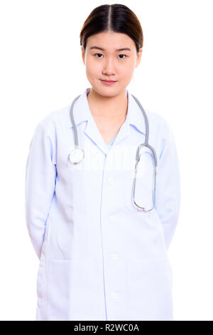 Studio shot of young beautiful Asian woman doctor with hands on  - Stock Photo