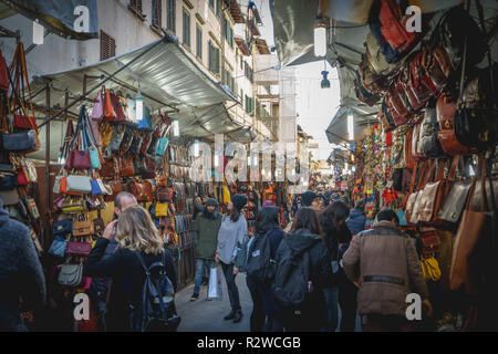 Florence, Italy - February, 2019. Stalls selling leather items in the market of San Lorenzo. - Stock Photo