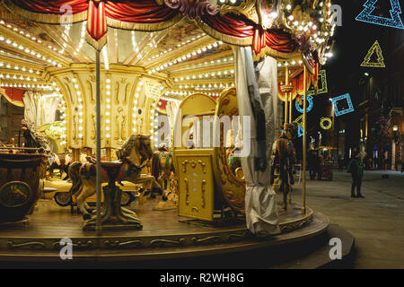 Perugia, Italy - January 2018. A vintage carousel situated along the main street of the city centre during Christmas time. - Stock Photo