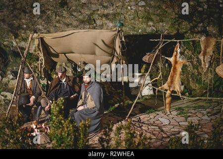Rasiglia (Foligno), Italy - January 2018. Hunters camping during a living Christmas Nativity scene reenactment. - Stock Photo