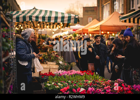 London, UK - January 2018. The Columbia Road Flower Market, a Sunday street market in the London Borough of Tower Hamlets. Landscape format. - Stock Photo