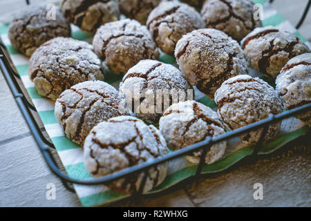 Close up view of chocolate crinkle cookies in a basket on a wooden table. Landscape format. - Stock Photo