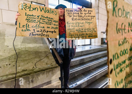 London, UK. 19th November 2018. Protesters from Focus E15 Mothers protest in the rain at centre right think tank Policy Exchange where former Newham Mayor Robin Wales now works and was speaking at a conference. They say he left office with 1 in 25 homeless including 2,000 families with children under 5, left the largest council bank debt of any local authority, kept hundreds of council homes empty for 10 years despite a huge waiting list and deleted 10,000 e-mails to avoid investigation. Policy Exchange brought out tea for the protesters who were going inside as I had to leave. - Stock Photo