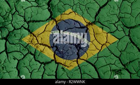 Political Crisis Or Environmental Concept: Mud Cracks With Brazil Flag - Stock Photo