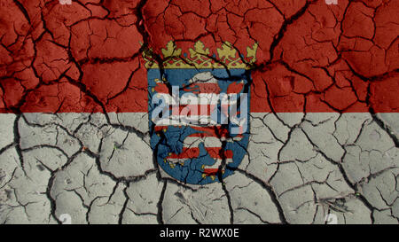 Political Crisis Or Environmental Concept: Mud Cracks With Hesse Flag - Stock Photo