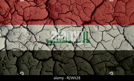 Political Crisis Or Environmental Concept: Mud Cracks With Iraq Flag - Stock Photo