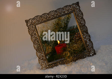 Advent arrangement in the nostalgic picture frame - Stock Photo