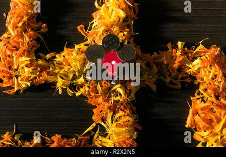 Illuminate diya placed on swastik for celebrating diwali and dhanteras - Stock Photo