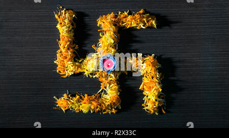 Illuminate diya placed on swastik for celebrating diwali and dhanteras - Stock Photo
