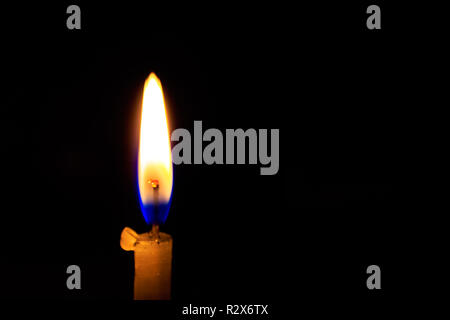 A burn or burning candle on black background, close up. Image taken in Diwali, a traditional celebration of Indian festival. - Stock Photo