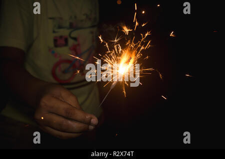 Selective focus. Fireworks Holiday firework in night Firecracker sparks. Happy new year decoration isolated. Explosion firecracker, holiday celebratio - Stock Photo