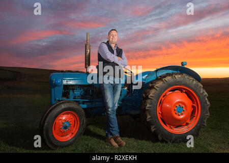 Former Scottish Rugby player Doddie Weir pictured with his Fordson Dexta Tractor on his farm near Galashiels. - Stock Photo