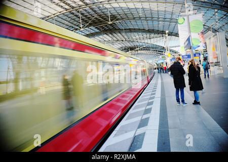 Berlin, Germany -the modern Berlin Hauptbahnhof main train station with S-Bahn train - Stock Photo