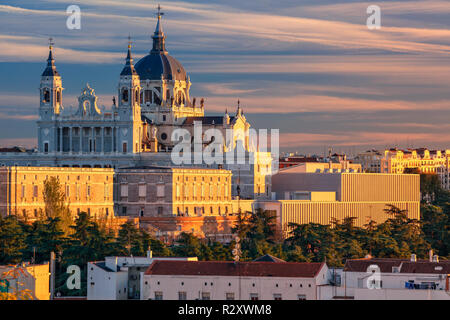 Madrid. Image of Madrid skyline with Santa Maria la Real de La Almudena Cathedral and the Royal Palace during sunset. - Stock Photo