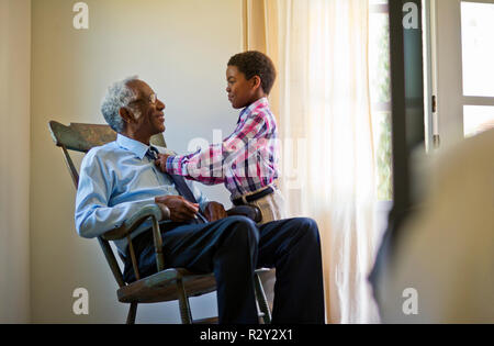 Smiling middle aged woman and her elderly father celebrating after working out a budget. - Stock Photo