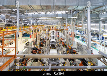 body of car on conveyor Modern Assembly of cars at plant. automated build process of car body - Stock Photo