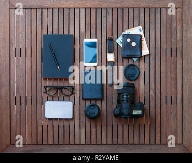 Man travel set and accessories on a wooden background. Top view - Stock Photo