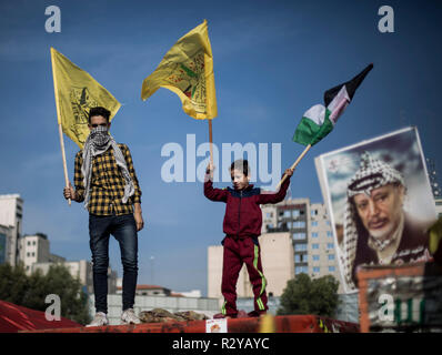 Supporters of Fatah movement's former security chief and exiled Palestinian politician Mohammed Dahlan seen holding flags during a gathering held for the 14th anniversary of Yasser Arafat's death in Gaza city. Yasser Arafat died at 75 years old in a French hospital on November 11th, 2004, while Palestinians accused Israel of having poisoned him. - Stock Photo