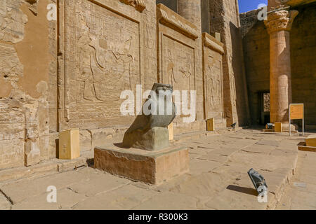 Granite falcon figure of the god Horus at The Temple of Edfu, an Egyptian temple on the west bank of the Nile in Edfu, Upper Egypt, North Africa Stock Photo