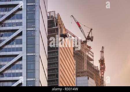Tower cranes on top of 22 Bishopsgate during construction in the City of London - Stock Photo