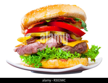 Nutritious double cheese burger with meat, fresh vegetables and pickles. Isolated over white background - Stock Photo