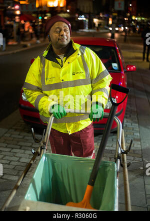 street cleaner at night, Camden High street London, - Stock Photo