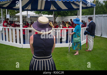 Watching the band at Henley Regatta, Henley-on-thames, Oxfordshire - Stock Photo
