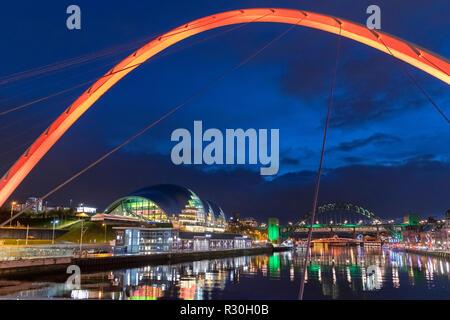 The Gateshead Millennium Bridge looking towards the Sage Gateshead and Tyne Bridge, River Tyne, Newcastle upon Tyne, Tyne and Wear, England, UK - Stock Photo