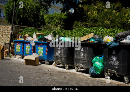 Large recycling and landfill bins on the side of a street in Heraklion, Crete. - Stock Photo