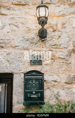 Lantern and mailbox at the door of the house. - Stock Photo