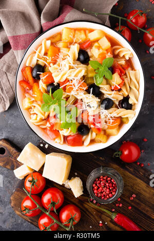 Minestrone, italian vegetarian soup with pasta and vegetables - Stock Photo