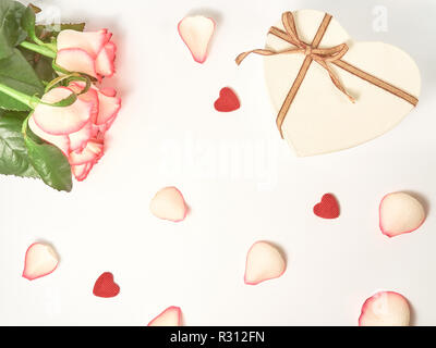 Gift and roses composition on the white background. Top view, flat lay. Birthday, Mother's, Valentines, Women's, Wedding Day concept. - Stock Photo