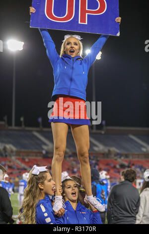 Dallas, Texas, USA. 16th Nov, 2018. A SMU cheerleader encourages the Mustang fans during the NCAA Football game between the SMU Mustangs and the Memphis Tigers at Gerald J. Ford Stadium in Dallas, Texas. Kyle Okita/CSM/Alamy Live News - Stock Photo