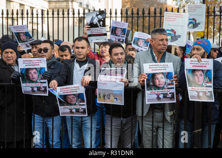 London, UK. 21st November, 2018. Members of the Hazara community, an ethnic group native to the region of Hazarajat in central Afghanistan, protest opposite Downing Street against a lack of assistance from the Afghan government in the face of attacks by the Taliban and Islamic State. Credit: Mark Kerrison/Alamy Live News