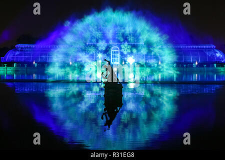 Kew Gardens, London, 21st Nov 2018. The Palm House Grand Finale with laser beams, streams of light and kaleidoscopic projections playing across a giant water screen, accompanied by Christmas music classics.Returning to the Royal Botanical Gardens at Kew is 'Christmas at Kew, an illuminated trail through Kew's after-dark landscape, lit up by over one million twinkling lights, and featuring spectacular light and sound installations along the route. (all child models were provided by the venue and consent was obtained) Credit: Imageplotter News and Sports/Alamy Live News - Stock Photo