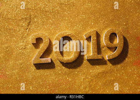 Happy New Year's layout. numbers 2019 notepad and free space for text. Christmas decorations, xmas toys, gold stars, gifts. - Stock Photo