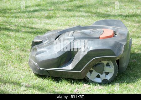 A husqvarna Automatic lawn mowing machine. - Stock Photo