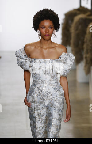 NEW YORK, NY - SEPTEMBER 08: A model walks the runways at Badgley Mischka - Runway during New York Fashion Week: The Shows at Gallery I at Spring Stud - Stock Photo