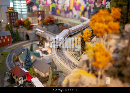 Visitors to the New York City Transit Museum in Grand Central Terminal in New York on Sunday, November 20, 2018 enjoy the 17th Annual Holiday Train Show. Lionel trains depart and arrive at Grand Central Terminal and travel around New York in miniature. The Metropolitan Transportation Authority announced that it is buying Grand Central Terminal as well as the Harlem and Hudson Lines for $35 million from Midtown Trackage Ventures, LLC, an entity created in 1970 from the ashes of the PennCentral railroad bankruptcy. (© Richard B. Levine) - Stock Photo