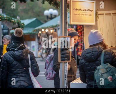 Shoppers browse the Union Square Holiday Market in New York on opening day, Thursday, November 15, 2018. Over 100 vendors sell their holiday wares at the market which includes a 'Lil' Brooklyn' section. Now in it's 25th year, the market will remain open daily, closing on December 24.  (© Richard B. Levine) - Stock Photo