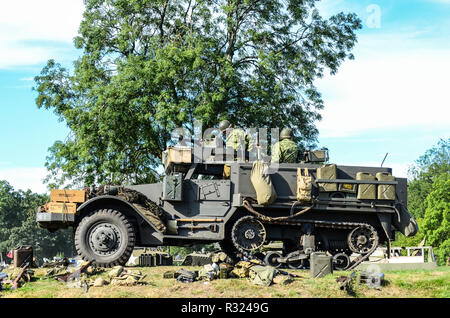 Second World War US Army recreation with M3 Half-track, known officially as the Carrier, Personnel Half-track M3, armored personnel carrier - Stock Photo