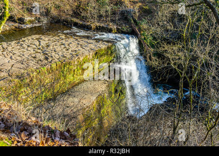 The sgwd clun-gwyn waterfall in the Fforest Fawr Geopark in the Brecon Beacons, Powys, Wales, UK - Stock Photo