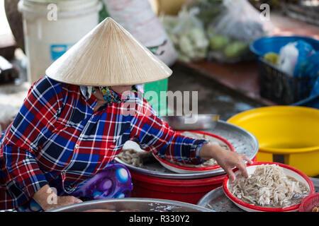 Market seller along the mekong delta early morning.  Mekong Delta, Vietnam, September 2017 - Stock Photo