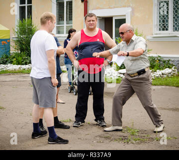Komsomolsk-on-Amur, Russia - August 1, 2016. Public open Railroader's day. referee shows mistakes of wrestlers in amateur wrestling competition - Stock Photo