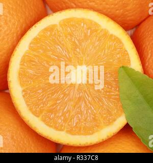 orange with an orange leaf - Stock Photo