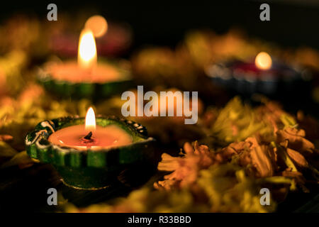 Diya lit for greeting card to celebrate diwali and dhanteras in India - Stock Photo